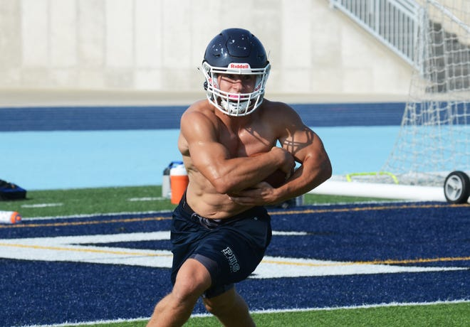Petoskey running back Rippin Vining takes a handoff around the edge during practice Tuesday. Vining, along with others, show signs of a strong offseason and summer program for the Northmen.