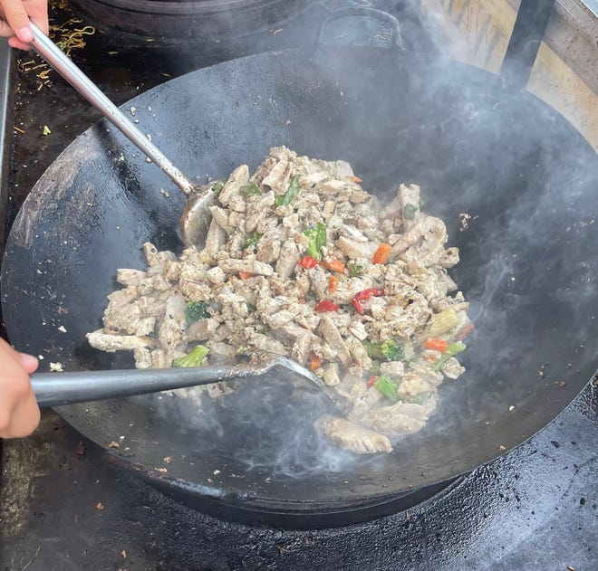 Island Noodles is a popular food choice among attendees of Musikfest. Pictured is the chicken being prepared in a wok.