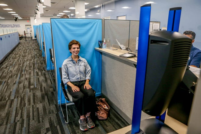 Transplanted New Yorker Amy Russo has her photo taken for her Rhode Island driver's license at the Division of Motor Vehicles branch in Woonsocket.