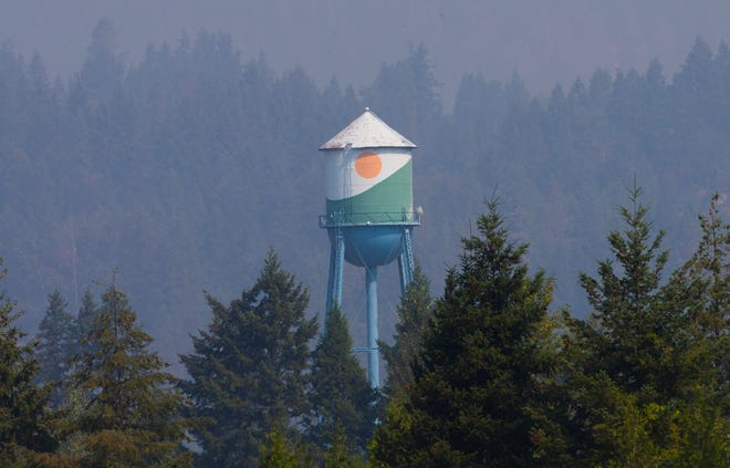 Smoke obscures the hill above an Oakridge water tower as the Middle Fork Complex fires burn nearby.