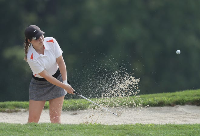 Hoover's Abby Blackburn hits her approach shot out of a trap on hole No. 4 during Wednesday's Jackson Polar Bears Match Play Invitational at Shady Hollow Country Club.