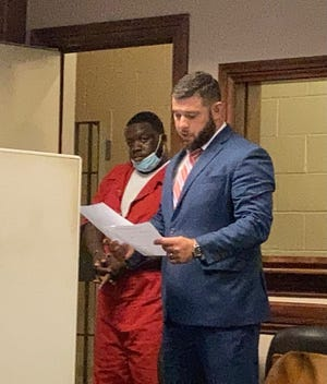 Nichalous D. Harvey, left, appears in Canton Municipal Court with defense counsel Ty Graham. Harvey is facing a murder charge, accused of fatally shooting Aaron Lucas of Canton.