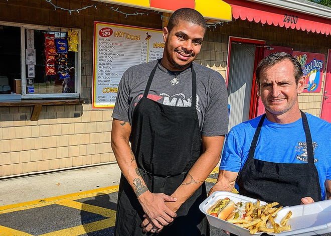 Hazel's Hot Dogs cook Melvin Hayes and owner Perry Zaharias stand in front of the restaurant on U.S. 1 in St. Augustine on Tuesday.