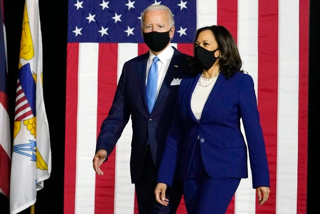 Democratic presidential candidate former Vice President Joe Biden and his running mate, Sen. Kamala Harris, D-California, arrive to speak at a news conference at Alexis Dupont High School in Wilmington, Delaware, on Aug. 12, 2020.