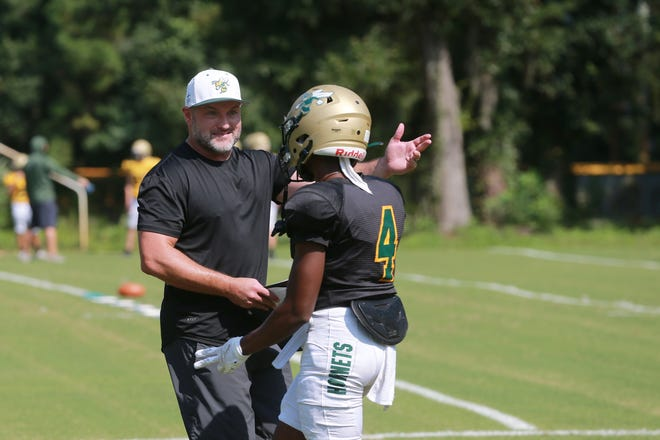 Savannah Country Day head coach John Mohring talks with Kenny Odom during practice.