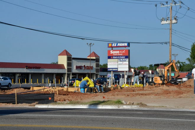 A crew gets ready to start the work day early Wednesday as construction continues for Scooter's Coffee, a business soon to operate on the northwest corner of Harrison and Independence, in Shawnee.