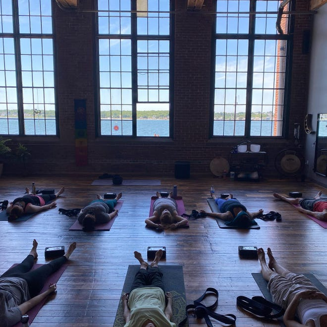 """Solshine offers sound healing, aromatherapy, reiki, meditation and energy medicine featuring a """"breathtaking view"""" of Clarks Cove through the studio's large mill windows."""