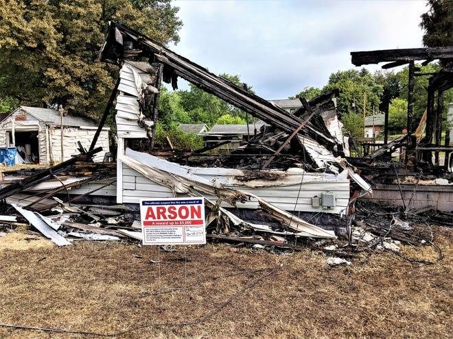 The cause of a fire at a vacant home on 7th Street in Lakemore is being investigated as being intentionally set.