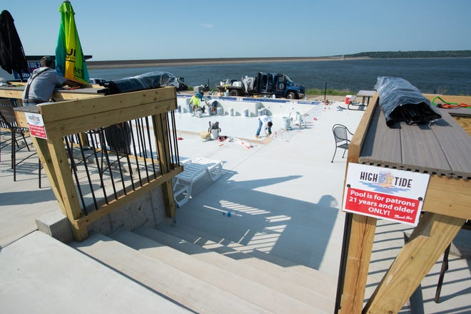 Crews work to complete the 21 years and older pool at High Tide 21, 10770 Perry Park Drive, at the Lake Perry Marina and Yacht Club on Wednesday afternoon.