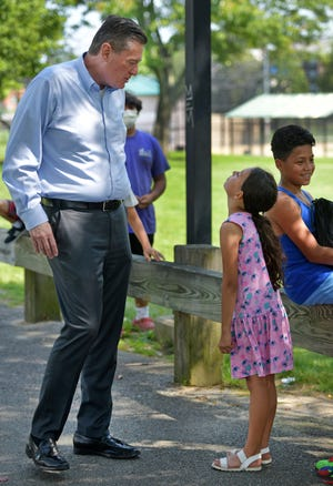 City Manager Edward M. Augustus Jr. talks to a young girl who participated in Recreation Worcester at the Vernon Hill Park fields Wednesday.