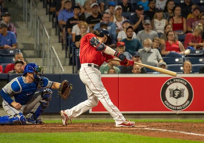 WooSox batter Ryan Fitzgerald hits a two-run homer last week against the Syracuse Mets at Polar Park.