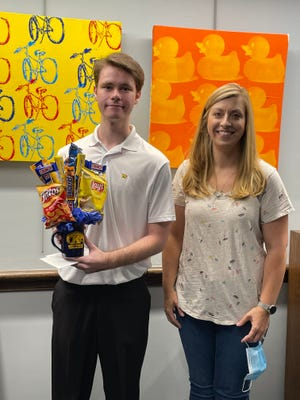 Ethan Morris (left) a recent New Philadelphia High School graduate, and Erin Jabs a Friends of the Library-NP board member.