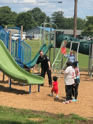 Newcomerstown Police Officer Fred West was one of the visitors for the grand opening of the new Southside Park in Newcomerstown. While there, Officer West took advantage and used the slide with some of the children who attended the event.
