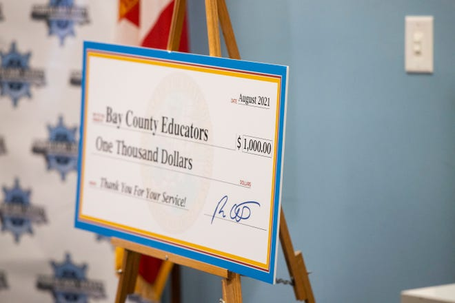 Florida Gov. Ron DeSantis passed out $1,000 checks to teachers at North Bay Haven Charter Academy Wednesday, August 11, 2021. The Gov. Held a press conference to show appreciation for the work teachers did during the COVID-19 pandemic.