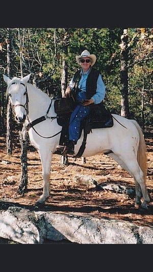 Priscilla Kirkpatrick poses atop her favorite horse, Blu.