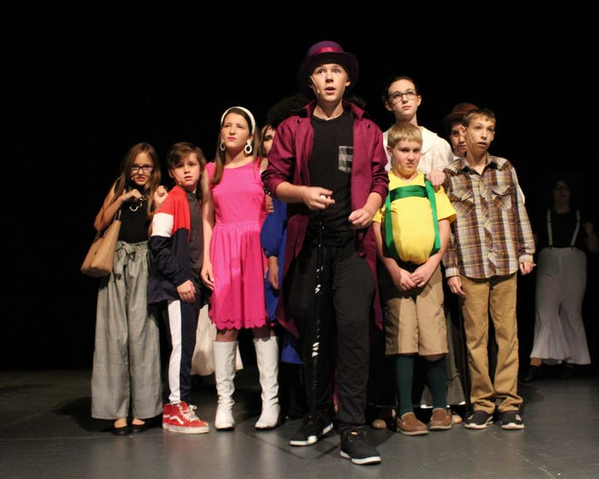 """Jonah Holmes (center) has duty in Big Country Performing Arts' """"Willy Wonka Jr.,"""" starring Wonka and also playing the Candy Man. He leads five youngsters with Golden Tickets and their adult chaperones through his magical candyland. The show is this weekend at Behrens Auditorium on the HSU campus."""