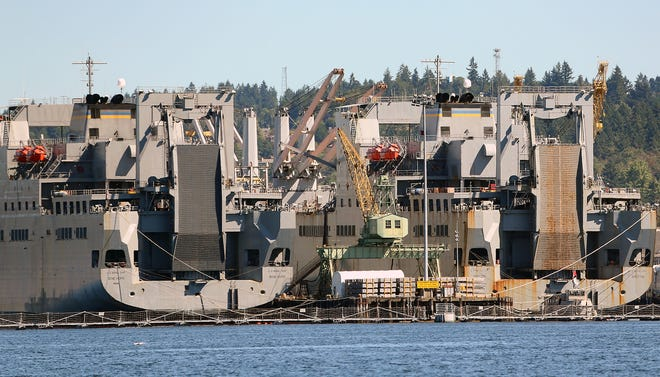 Crane 30 sits at the end of the pier in between the USNS Bob Hope and the USNS Britton at PSNS on Aug. 11.