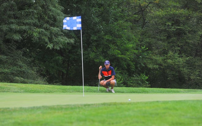 Galion's Nick McMullen eyes his upcoming putt on the 17th hole at NorthStar Golf Club