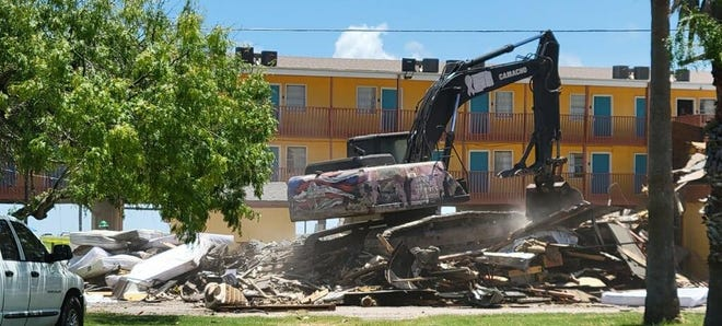 """One of buildings of the Knights Inn Corpus Christi caught on fire, burning three rooms and the entire roof March 30. The building at 3615 Timon Blvd. posed an """"immediate danger' for four months, City Manager Peter Zanoni said. The 10-unit section was finally demolished by its owners Monday."""