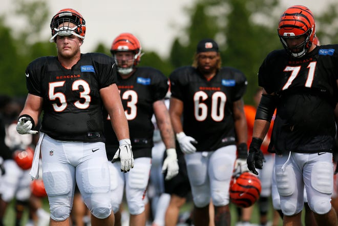 Cincinnati Bengals center Billy Price (53) and offensive line walk between fields during a training camp practice at the Paul Brown Stadium practice facility in downtown Cincinnati on Wednesday, Aug. 11, 2021.