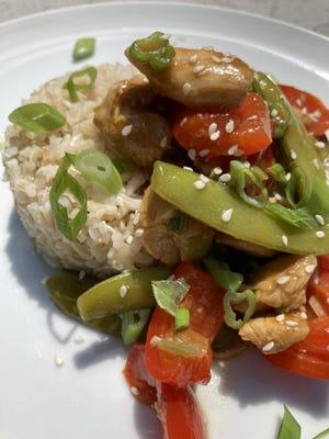 Orange Chicken Stir Fry is served over brown rice.