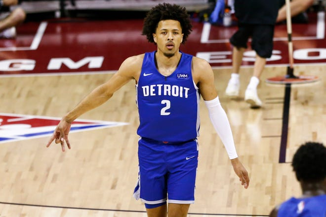 Pistons guard Cade Cunningham celebrates a 3-point shot against the Rockets on Aug. 10 in Las Vegas.