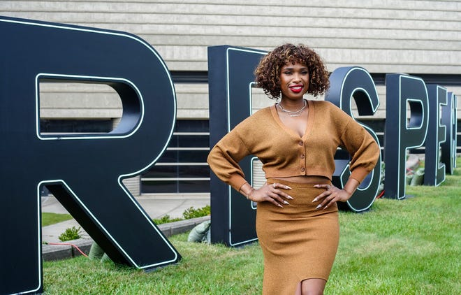 Jennifer Hudson poses in front of the respect letters outside of the Charles H. Wright Museum in Detroit on Sunday, August 1, 2021. The museum held a RESPECT Celebration and Conversation with actress Jennifer Hudson, Respect director Liesl Tommy, and Neil Barclay, President of the Charles H. Wright Museum in the theatre.