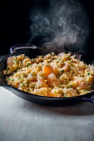 """The original recipes in """"Kevin Belton's Cookin' Louisiana"""" include a Cajun shrimp bowl. (Courtesy of Gibbs Smith)"""