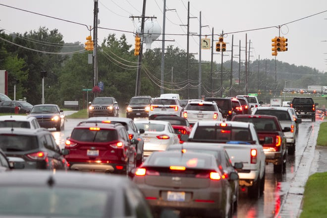 The traffic light at Grand River Avenue and Charles H. Orndorf Drive in Brighton is out Wednesday, Aug. 11, 2021 after a strong storm knocked out power for thousands in the county.