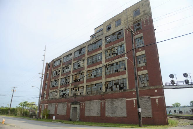 The Richland County Land Bank plans to acquire a Westinghouse building that towers over Fifth Avenue.