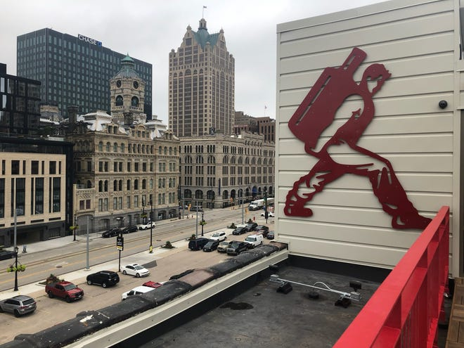 A large Central Standard logo is on the wall of the rooftop patio that overlooks Milwaukee's downtown.
