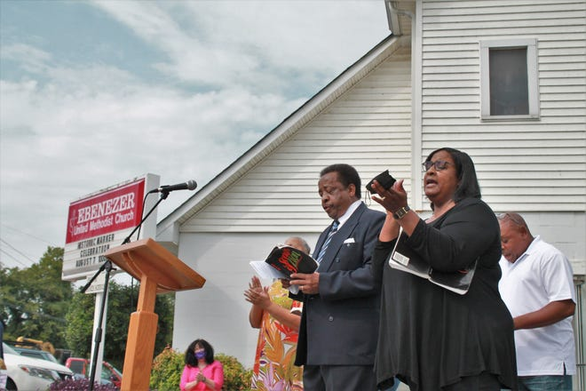 """Congregation members of Ebenezer United Methodist Church, Nolensville's first African American church, sing spirituals from book """"Songs of Zion"""" in celebration of the church's new historical maker on August 7, 2021."""