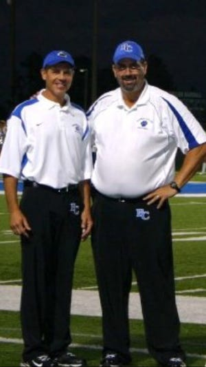 Barron Collier's first football coach Ken Andiorio (right) poses with assistant coach Rick MacCluggage after a game in October 2016. Andiorio recently retired after 27 years in school.