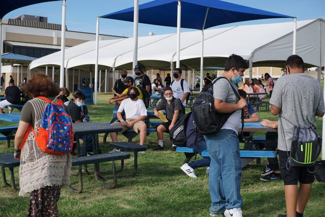 Carlsbad High School students wait for class to start on first day of the 2021-2022 school year.