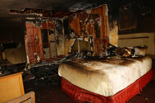 Firefighters extinguished a fire inside a room at Caliente Tropics Resort Hotel in Palm Springs, Calif., on August 11, 2021. The fire is under investigation as the hotel had no records of anyone checked into the room.