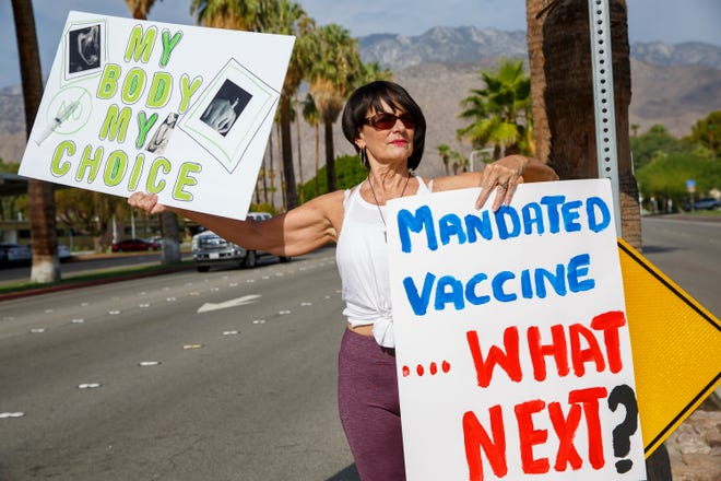 Health care worker Jade Keiner of Palm Desert protests against the new state requirements that all health care workers and long-term care workers must be fully vaccinated against COVID-19 by the end of September, in Palm Springs, Calif., on August 11, 2021.