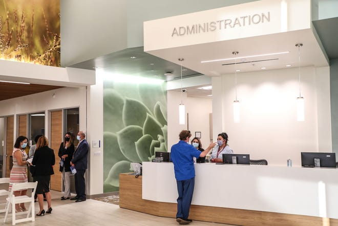 People tour the newly opened Palm Springs Community Health Center in Palm Springs, August 10, 2020.