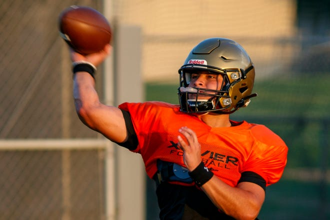 Ryder Ruiz throws the ball during practice at Xavier College Prep in Palm Desert, Calif., on August 9, 2021.