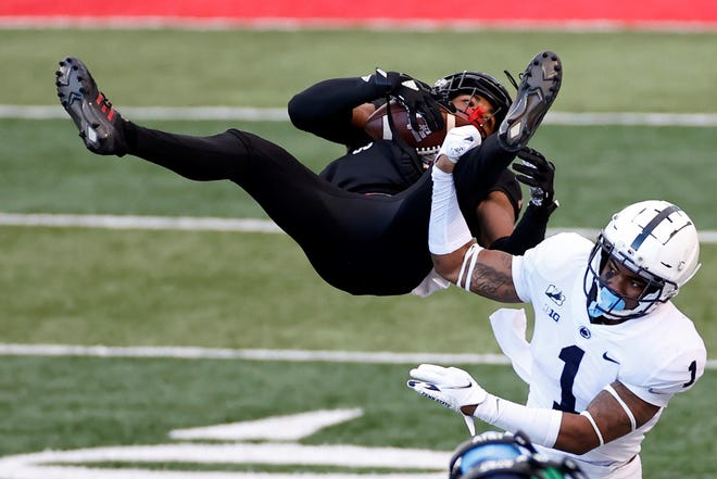 Rutgers wide receiver Bo Melton is upended by Penn State safety Jaquan Brisker (1) during the second half of an NCAA college football game Saturday, Dec. 5, 2020, in Piscataway, N.J. (AP Photo/Adam Hunger)