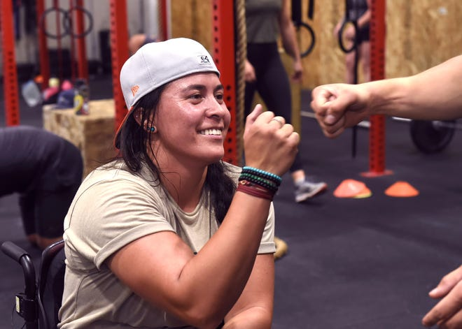 Shelby Estocado gets a fist bump during a break in her CrossFit class at Reno Power House Fitness in Reno on August 10, 2021.