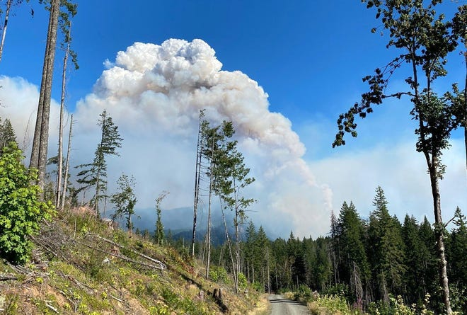 Smoke rises from the Gales Fire, part of the Middle Fork Complex, on August 7.