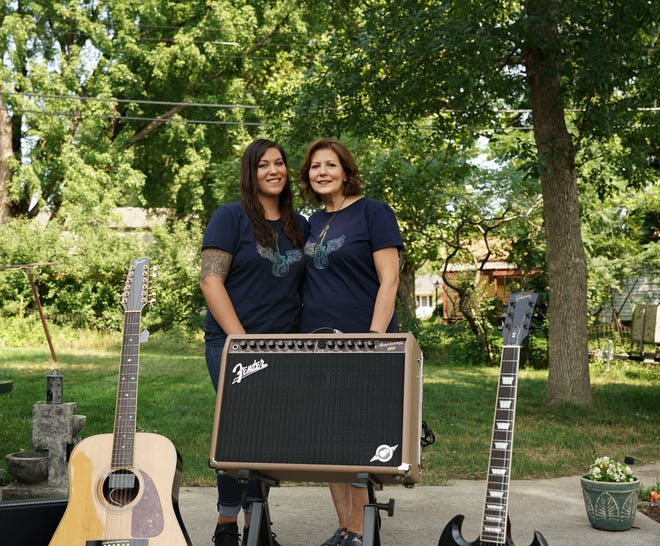 Rachel and Michelle Miller standing behind some of the items from Michelle's late husband's collection that will be auctioned on Saturday, August 14, 2021.