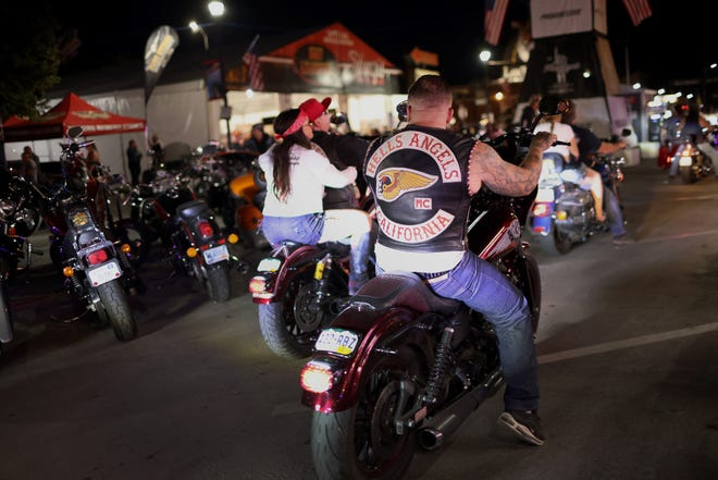 STURGIS, SOUTH DAKOTA - AUGUST 09: Motorcycle enthusiasts attend the 81st annual Sturgis Motorcycle Rally on August 09, 2021 in Sturgis, South Dakota. The rally is expect to draw more than 500,00 people during its 10-day run. (Photo by Scott Olson/Getty Images)