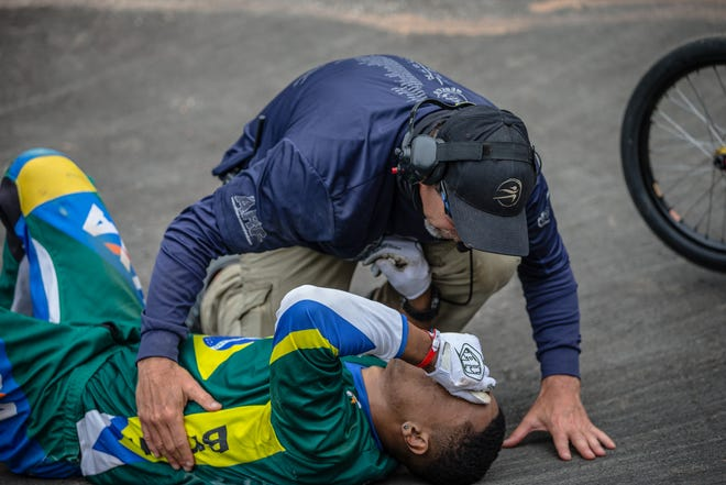 Scott Blatt, who is the head athletic trainer at Westlake High, tends to an injured rider during the 2016 UCI BMX World Championships in Medellin, Colombia.