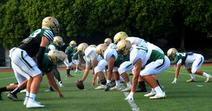 The offense lines up against the defense during St. Bonaventure's football practice on Tuesday, Aug. 10, 2021. St. Bonaventure left the Camino League to rejoin the Marmonte League for the fall 2021 season.