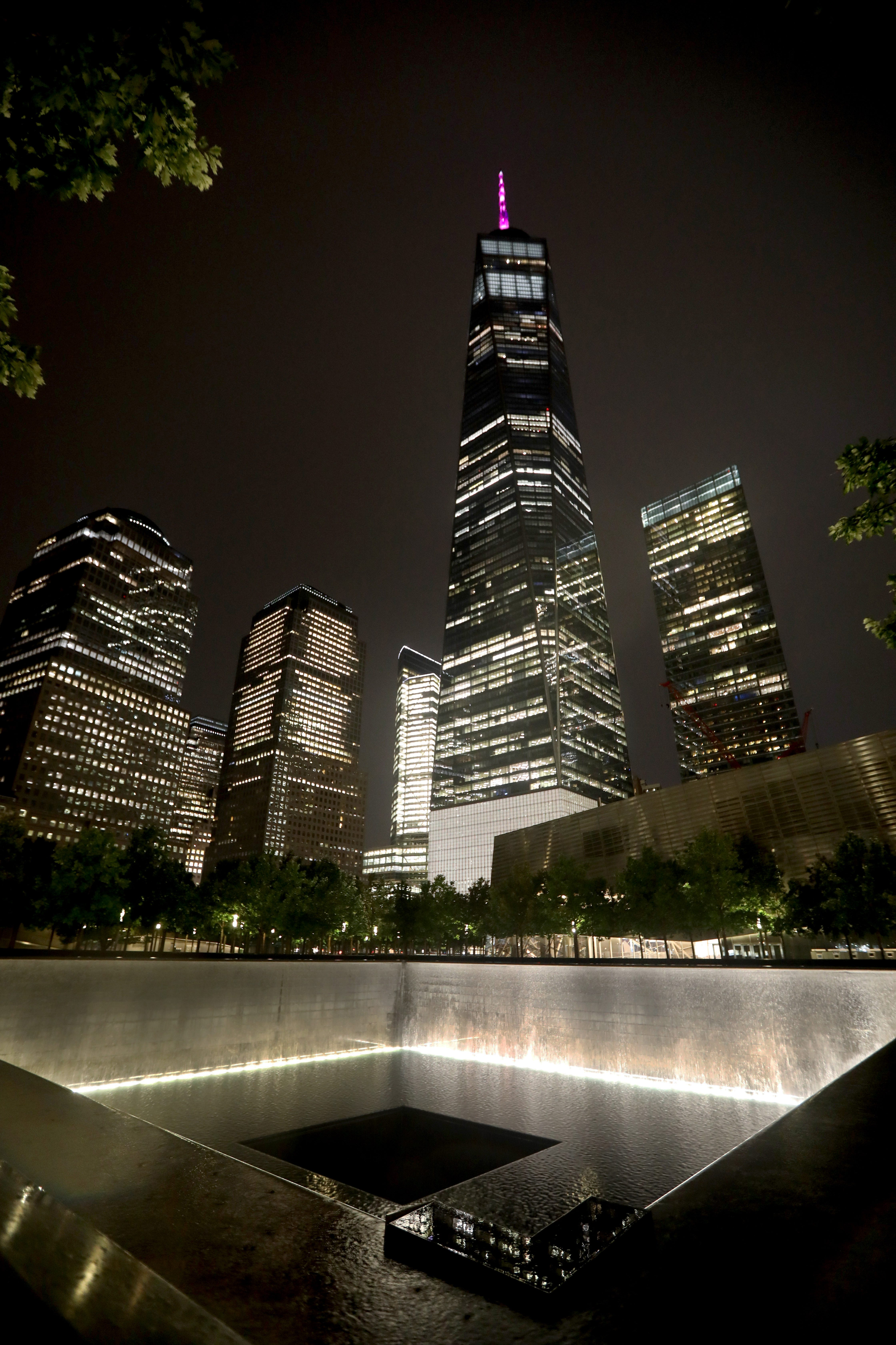 The 9/11 Memorial and One World Trade Center in Manhattan, photographed at night Aug. 10, 2021. The Memorial has not been open to the public at night since before the COVID-19 pandemic, and will only be open at night on Sept. 11th, to commemorate the 20th anniversary of the 9/11 attacks.