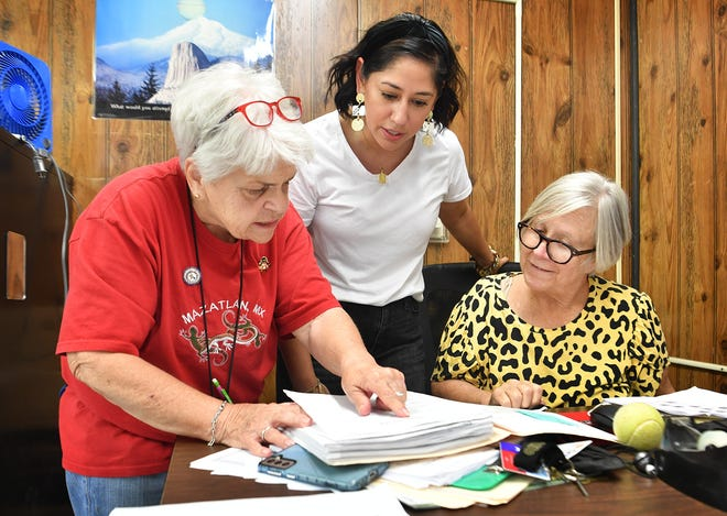 Phyllis Wright, left, talks with collegues Vanessa Parish and June Davison, right, while preparing for her 49th first day of school Wednesday. Wright teaches special education at Rider High School.