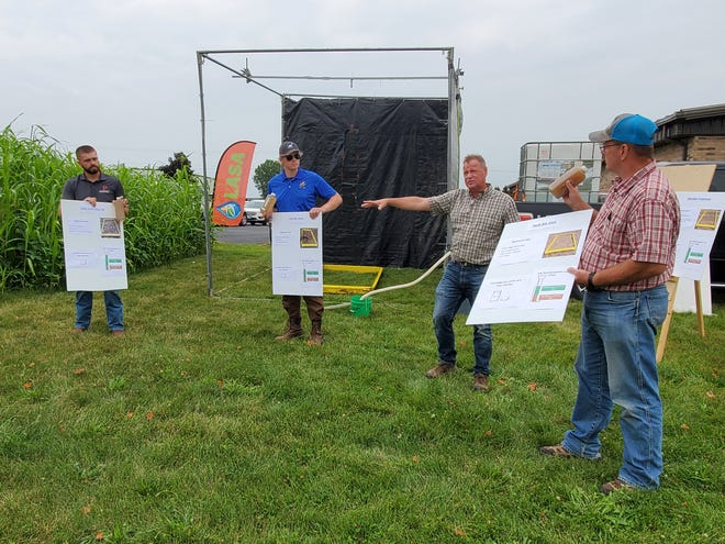 Professor Dennis Busch from the University of Wisconsin-Platteville talks about the results of a field project during a Lafayette Ag Stewardship Alliance field day on July 30 at the U.S. Department of Agriculture Service Center in Darlington, Wis. Busch's team developed a rainfall simulator to demonstrate the impact of conservation practices on water quality.