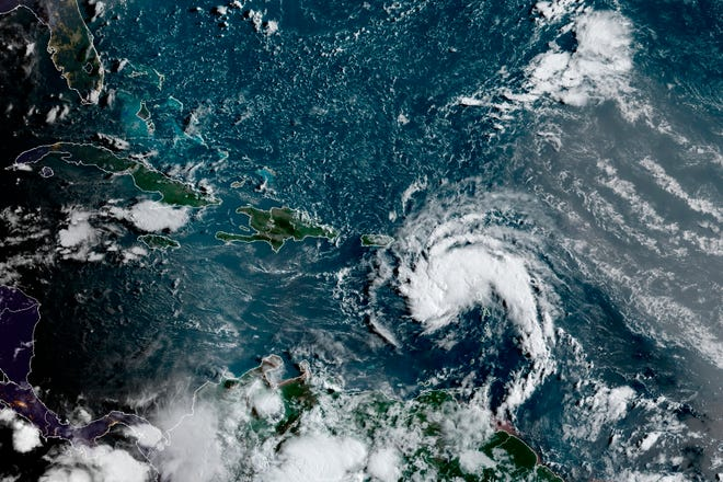 This satellite image provided by the National Oceanic and Atmospheric Administration shows Tropical Storm Fred near Puerto Rico late Tuesday.