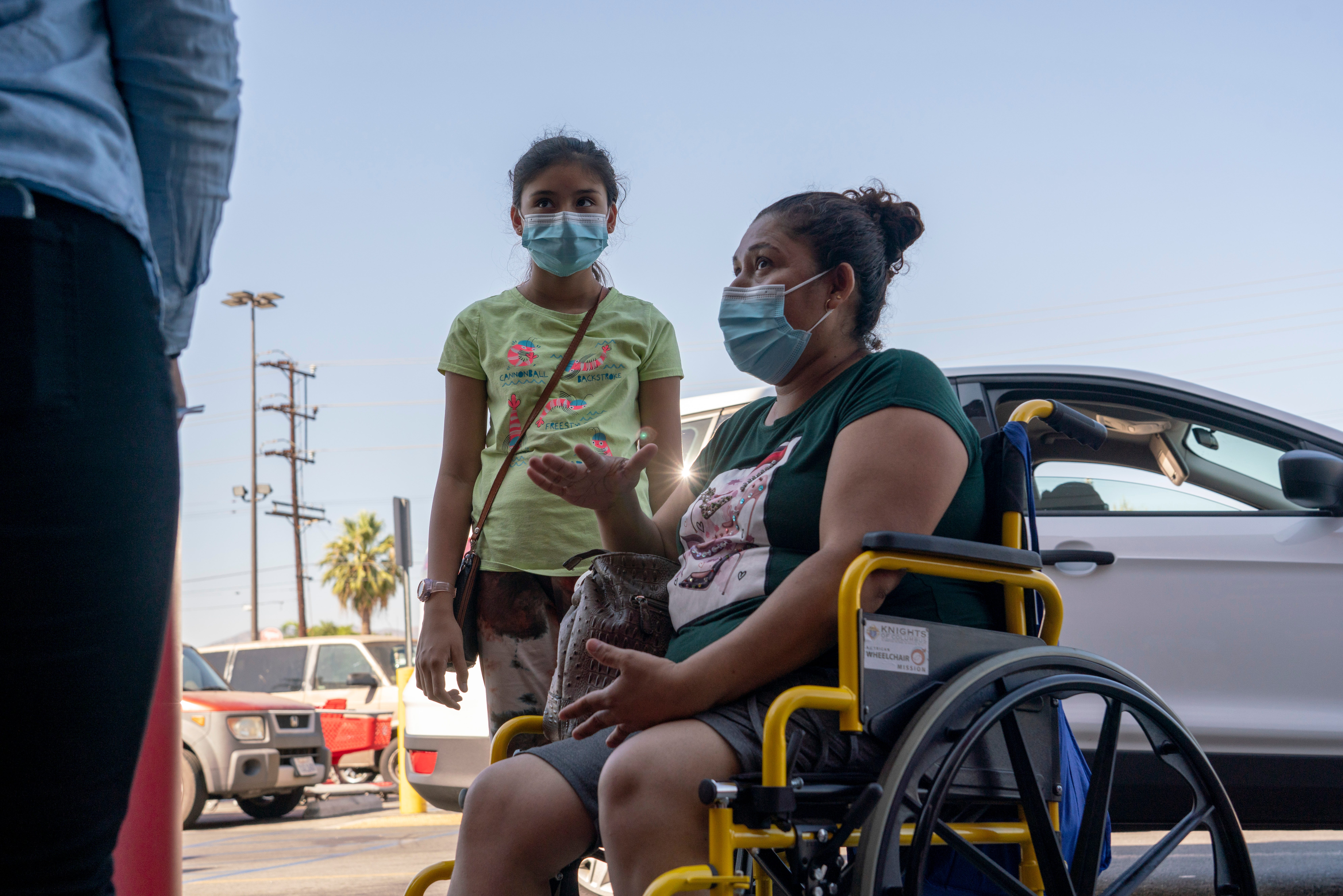 """Edia Cordero and her daughter Jasmin, 11, talk with community organizers outside a Target store in Pacoima last week. Cordero, who is unvaccinated, says she would get her daughter vaccinated if Los Angeles schools require it. """"As a mom, I'd do anything to protect my daughter, and if that means getting the vaccine, I'll do it."""""""